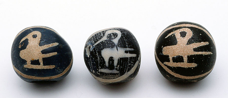 Ancient glass bird bead flanked by two Indonesian replicas from the 1980s. RKL