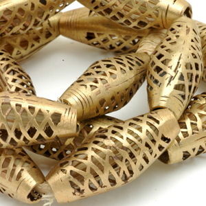 Brass beads from Ghana that have been polished smooth on a grinding wheel. CW