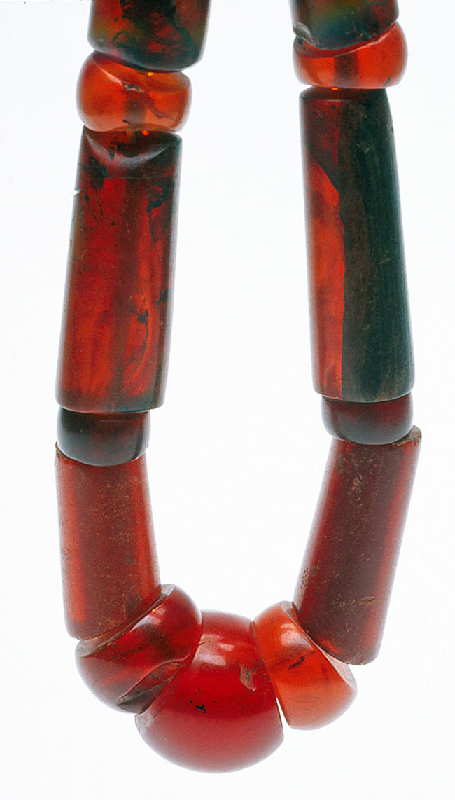 Burmese amber showing the characteristic shapes and color; longest beads about 8 cm long (3 inches). RKL