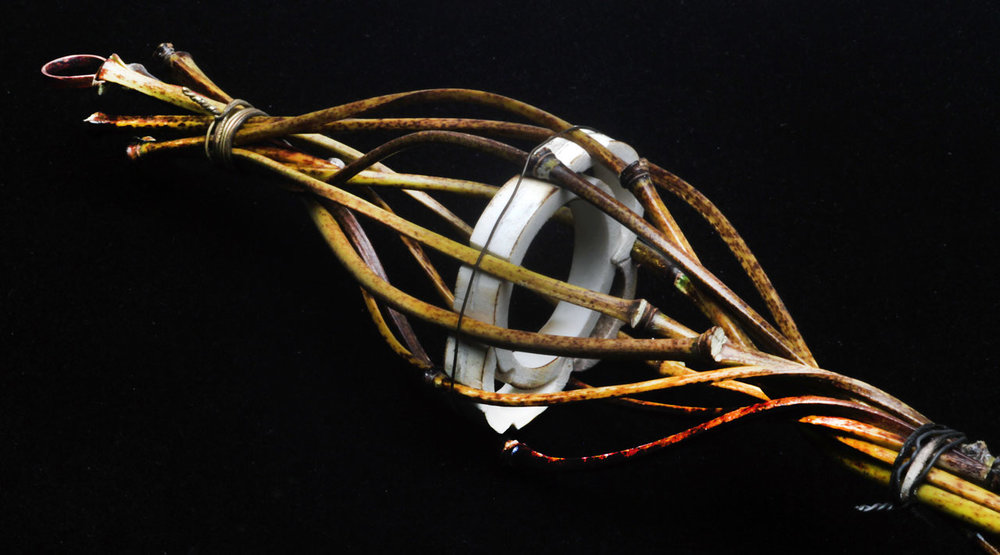 CLOSEUP OF JIGGED PENDANT, still with temporary wirebinding and plastic pipe jig in place. Note that individual culms have pleasing curves and the swirled bamboo has much more shape and resemblance to a basket or lattice-work.
