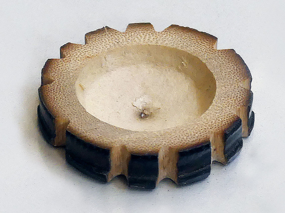 UNDERSIDE OF BAMBOO JIG, showing that it is nearly hollow, with only a thin layer of the culm in the center.