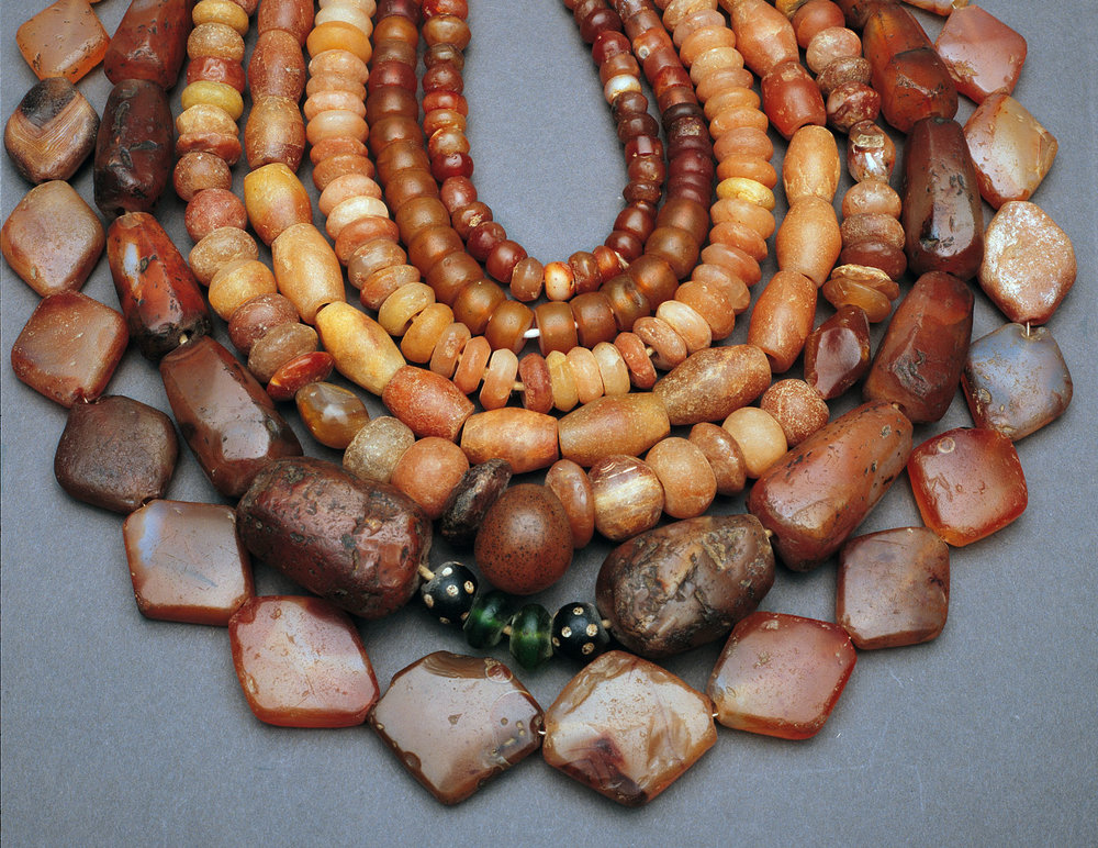 Assortment of carnelian beads from the African trade, most probably Indian made, some indigenous African production, and a few Venetian glass beads. Courtesy of Picard Collection. RKL