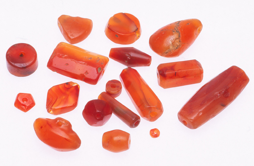 Assorted shapes and sizes of vintage carnelian beads from the African trade, all products of the Cambay stone industry. RKL