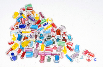 Contemporary cased glass beads. Clear glass casing adds depth and luster to drawn glass beads. RKL