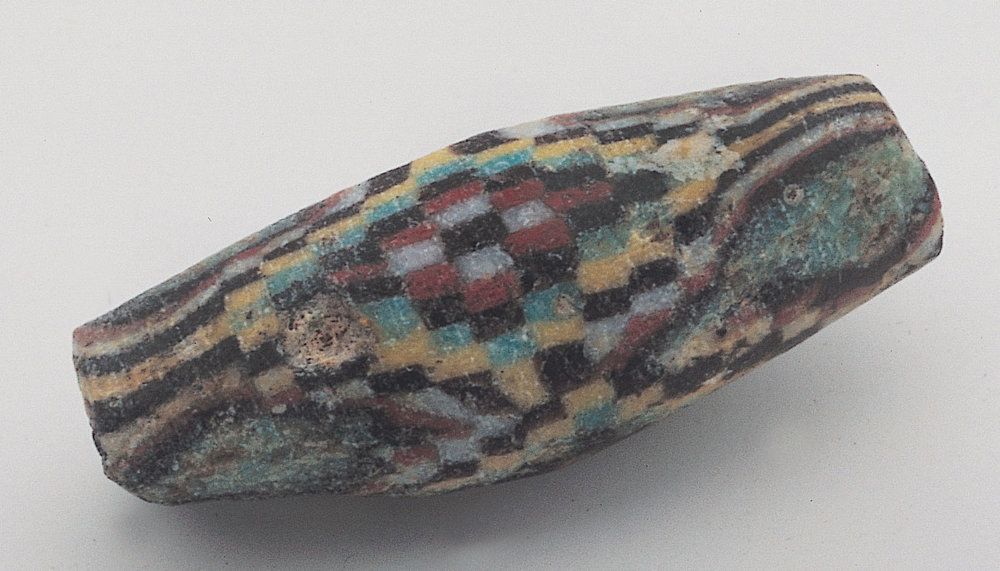 Chequer bead, ca. 100 BCE-100 CE, 2.2 cm long, weathered.  Courtesy of Lost Cities.  RKL