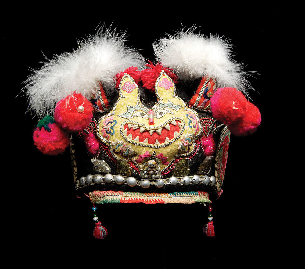 Beadwork Adorns the World:  BOY'S HAT, Bai peoples, Dali county, Yunnan province, People's Republic of China, of silk, cotton, metal beads and objects, feathers, yarn, embroidered appliquéd applied trim, diameter: 14.0 centimeters, twentieth century.  Photograph by Addison Doty.