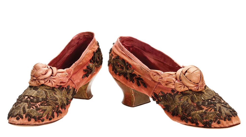 """Walk This Way:  BOUDOIR SHOES of silk and metallic thread, by Carlo, retailer, Paris, 1867. These shoes were created especially for the Paris Universal Exposition of 1867. The soles are stamped with the exhibition seal. During the age of European imperial expansion, Western consumers clamored for """"exotic"""" textiles, such as the Turkish gilt-thread embroidery seen on these shoes."""