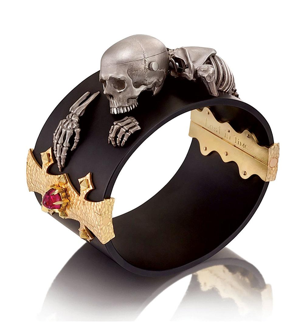 Uneasy Beauty:  LOST IN TIME BRACELET AND WATCH by Kim Lilot of eighteen karat and fourteen karat gold, Rolex watch, iron, steel,  tamahagane  (Japanese metal for swordmaking), rubellite, tourmaline, diamonds,  urushi  finish,7.6 x 7.6 x 3.8 centimeters.