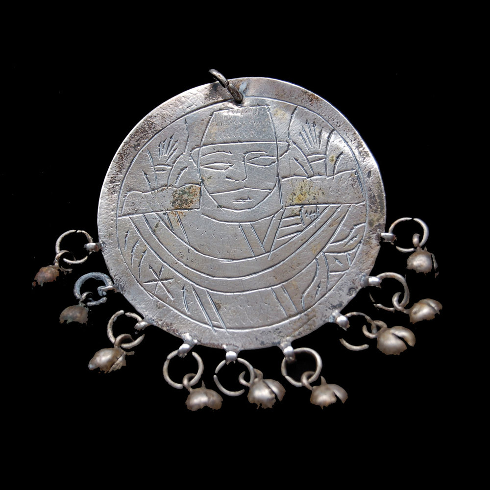 Egyptian Zar Jewelry:  SILVER ZAR PENDANT SHOWING DEPICTION OF MILITARY OFFICER; 1937.  Photograph by Sigrid Van Roode.