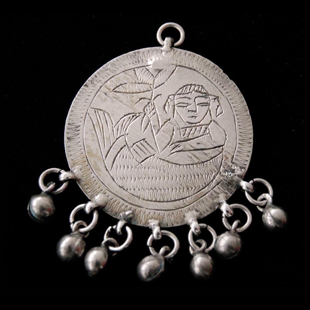 Egyptian Zar Jewelry:  SILVER ZAR PENDANTS FEATURING THE MERMAID SPIRIT SITT SAFINA; 1933.  Photograph by Sigrid Van Roode.