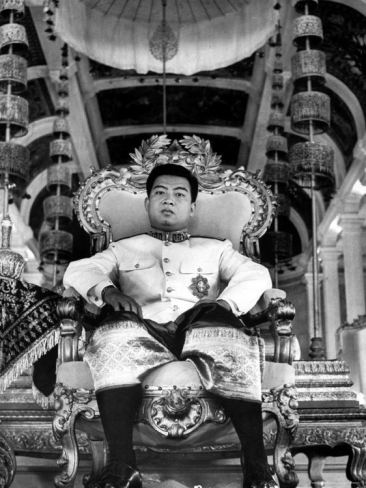 Sihanouk on his coronation throne   (click to enlarge)