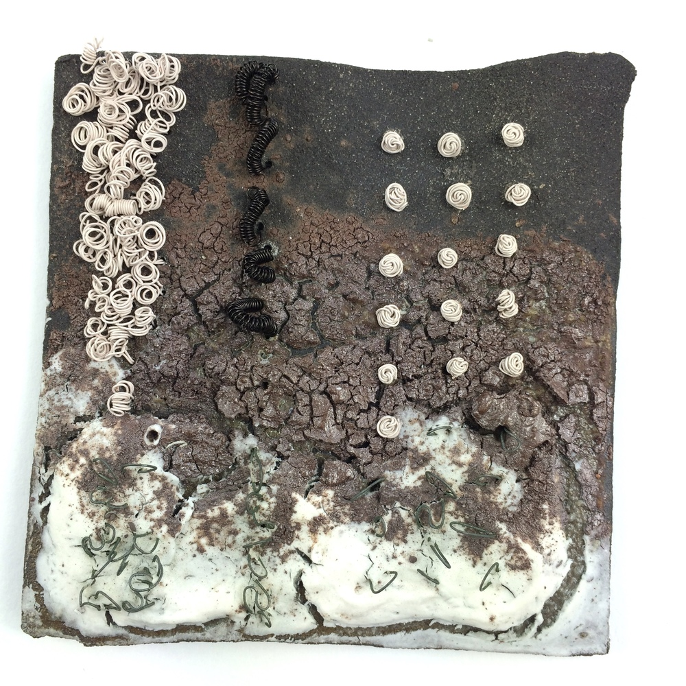 Solway Winter Estuary Tile. Black clay, porcelain, copper, titanium wire. Jan Goodey.