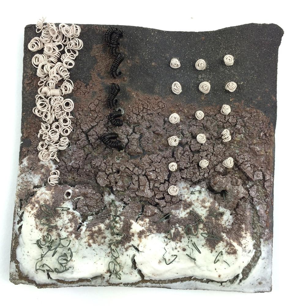 Solway Winter Estuary Tile. Black clay, porcelain, copper, titanium wire. Jan Goodey.