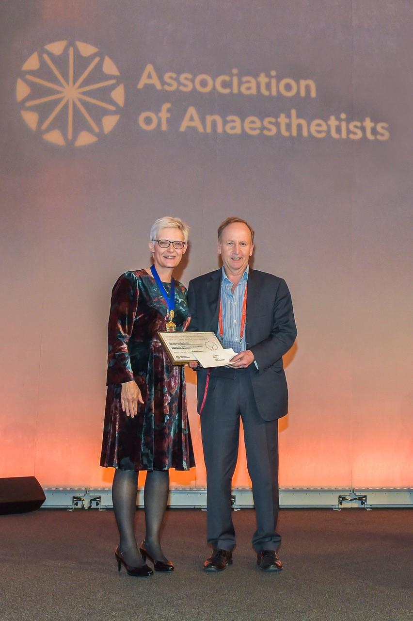 Dr Paul Upton accepting the innovation award from Dr Kathleen Ferguson