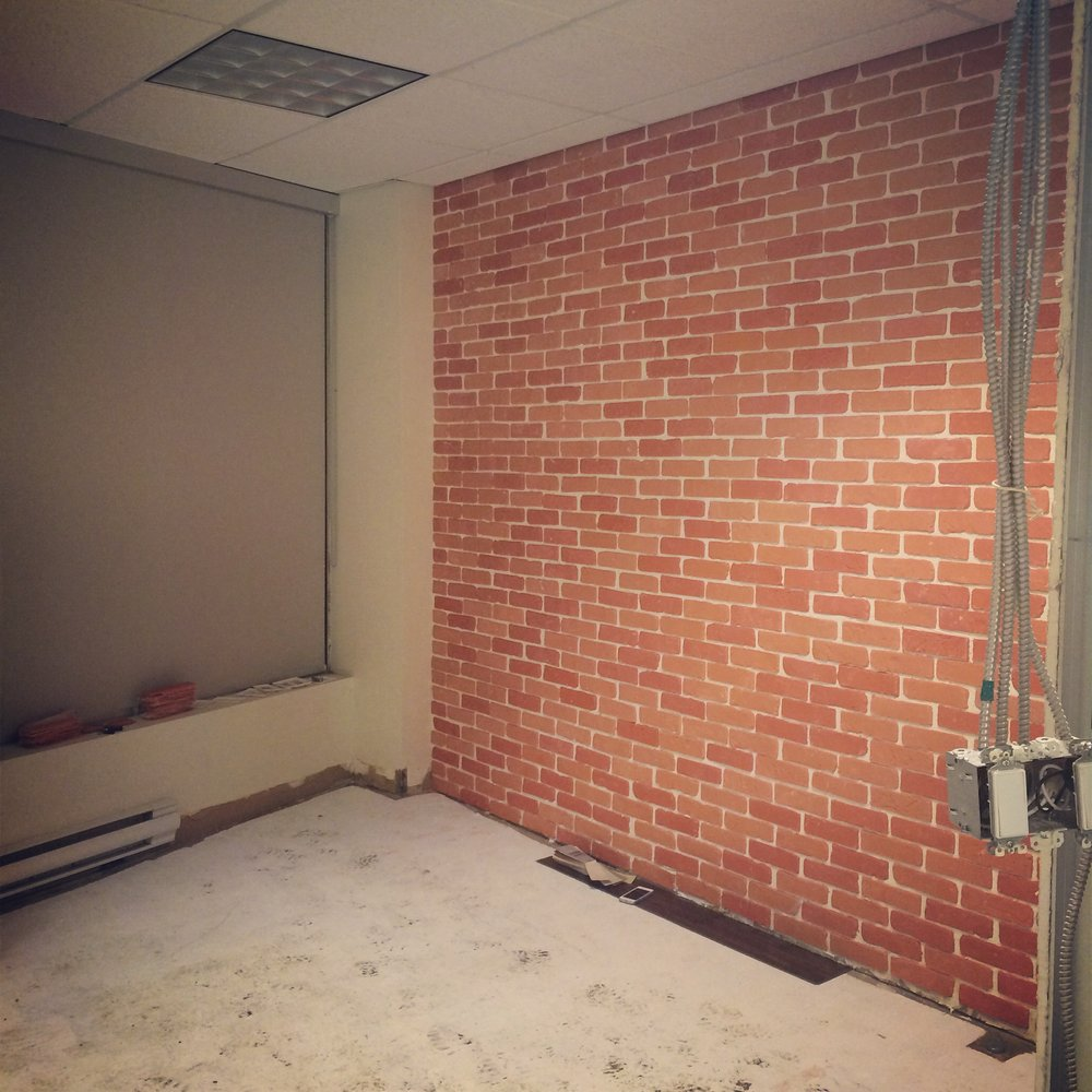 "The ""brick"" wall, pre-paint and grout."