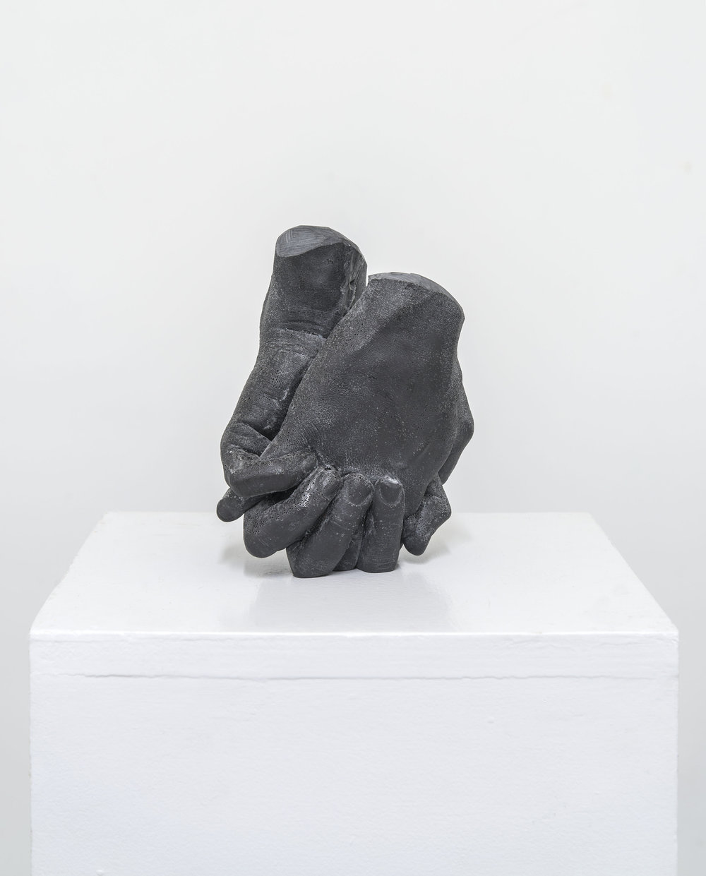 "holding , 2017, cast graphite, 6-3/4 x 5-1/2 x 3"""