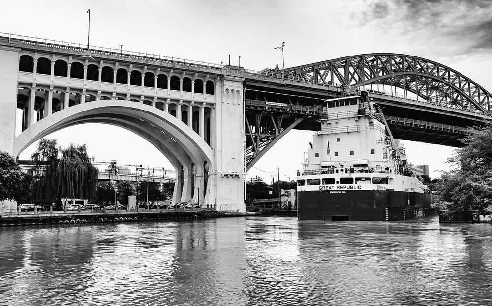 Great Republic freighter passing under the Detroit Superior Bridge on its way up river.