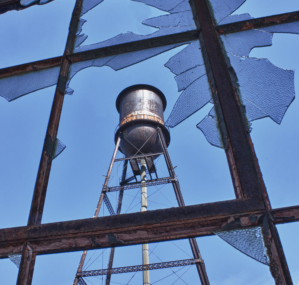 Water Tower Through Broken Window