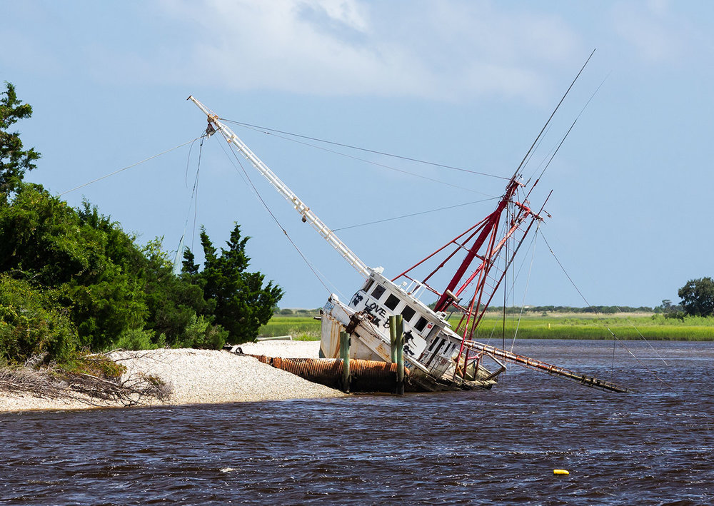 Grounded shrimp boat that was left as is.