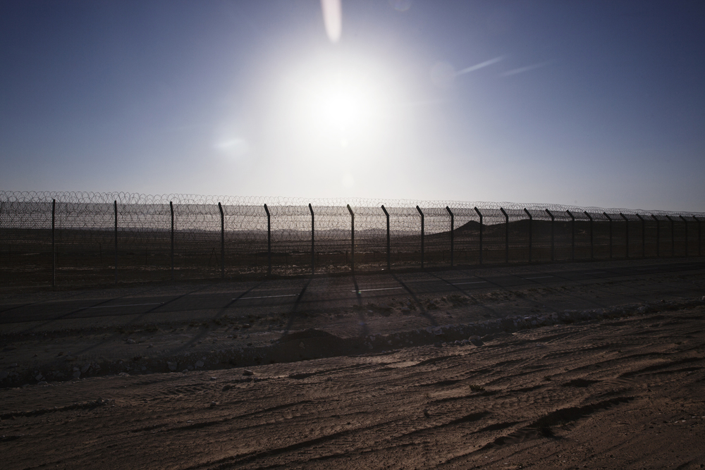 Fence between Egypt and Israel, it was built in order to stop the flow of Africans entering into Israel. The government used African workers to construct the fence.
