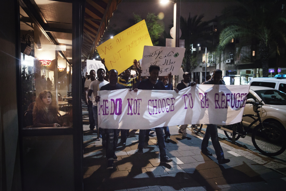 African asylum-seekers demonstrating the new detention law for African asylum seekers on their way to Rabin Square in central Tel Aviv.