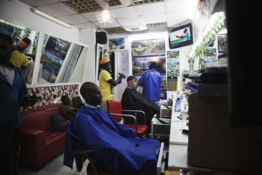 A barbershop in Neve Sha'anan; an area in Tel Aviv where African asylum-seekers have opened stores and businesses.