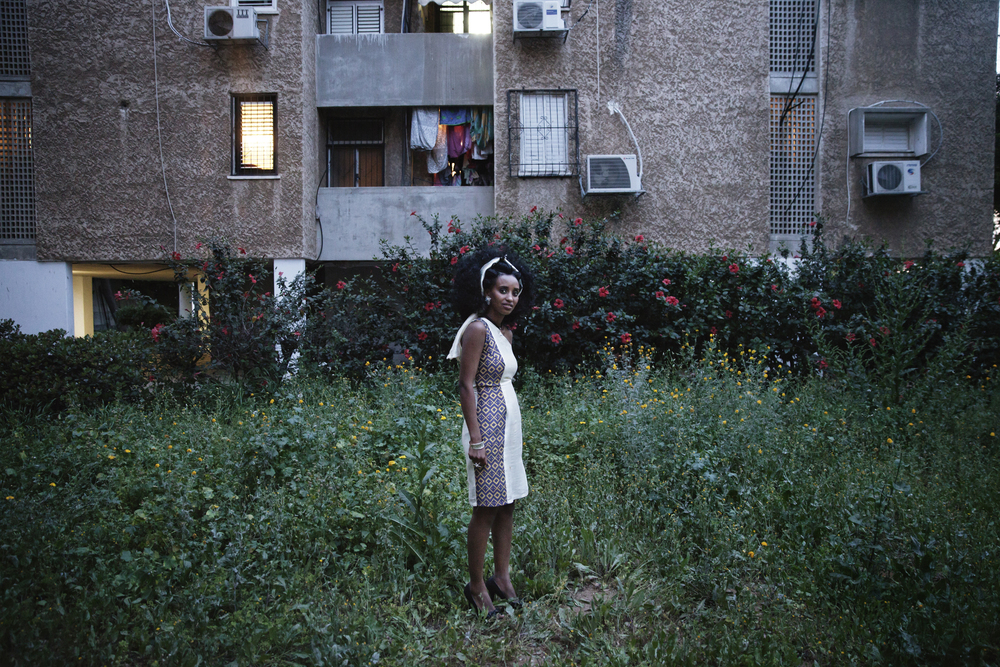 """Samravit Solomon, a 24 year-old Eritrean asylum-seeker leaving a birth-day party in Tel Aviv. """"Language is power, because as soon as I learned Hebrew, I was able to speak for myself, my family and the Eritrean community in Tel Aviv."""""""