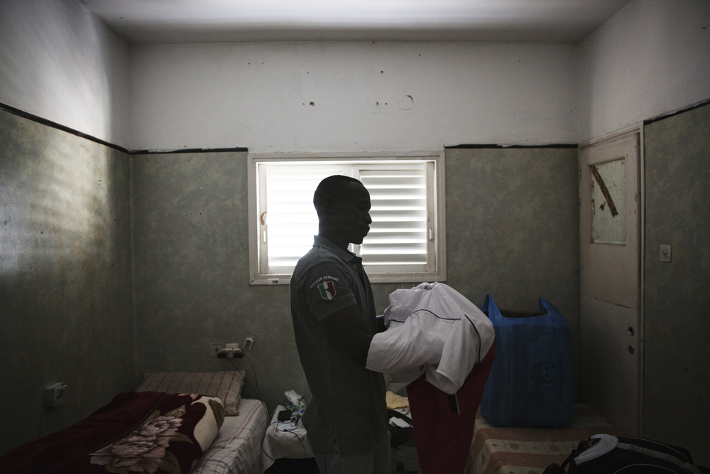 """Ahmed Dahiya, 29, is packing to go to Holot detention center. """"I have no idea what the future holds for me, one thing I am certain of, is that if I return to Sudan, I face life in prison or death."""" Going back to Sudan is not an option for me."""""""