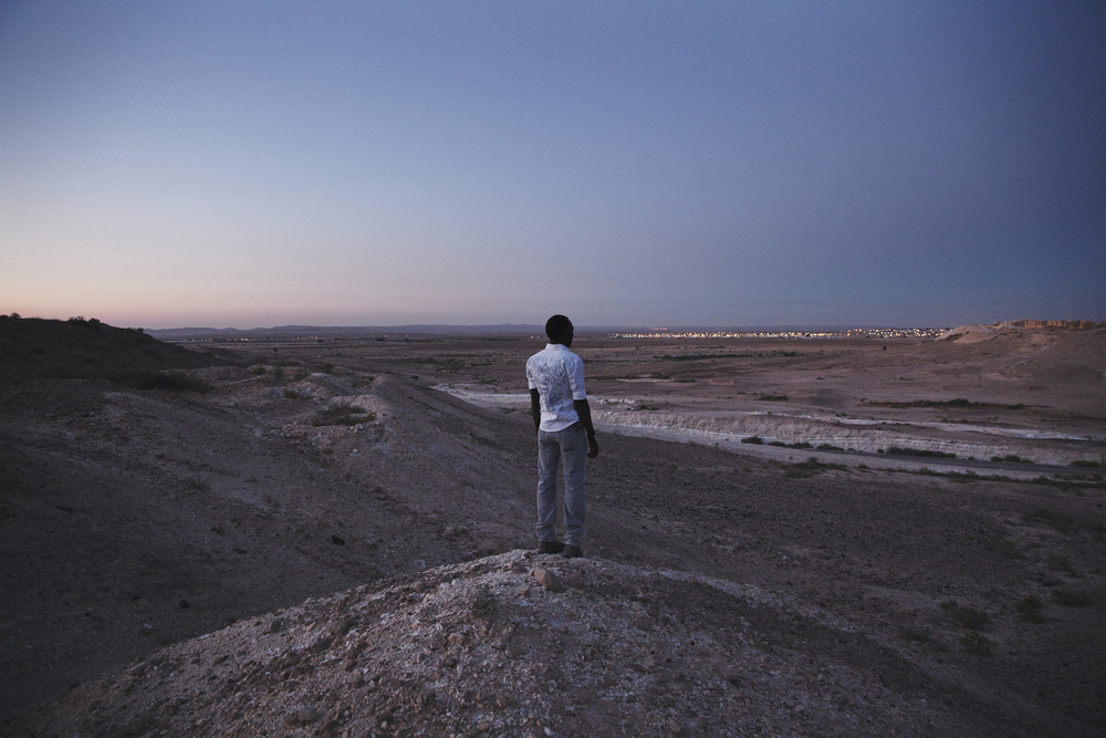 """Nouraldin, 26 years old has been in Holot since March 9th of 2014. He is a refugee from Sudan, Darfur. """"Yesterday was the first time I ever lied to my mother. She asked me where I was, and I told her I was in Tel Aviv and everything is fine."""""""