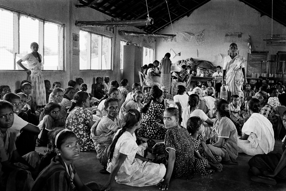 Women waiting to get food coupons from the World for Food Program, Batticaloa, Sri Lanka, 2007.