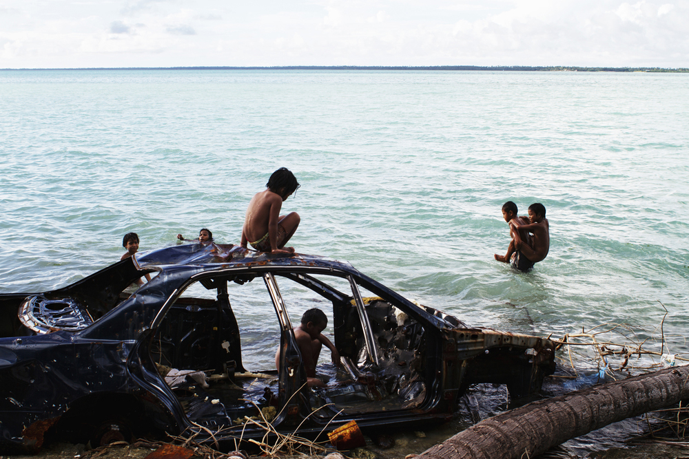 A disposed car in the lagoon on the Island of Tarawa. As Kiribati moves towards a more modern economy their consumption patterns have changed. As a result the lagoon is heavily polluted by solid waste disposal. Kiribati. 2010.