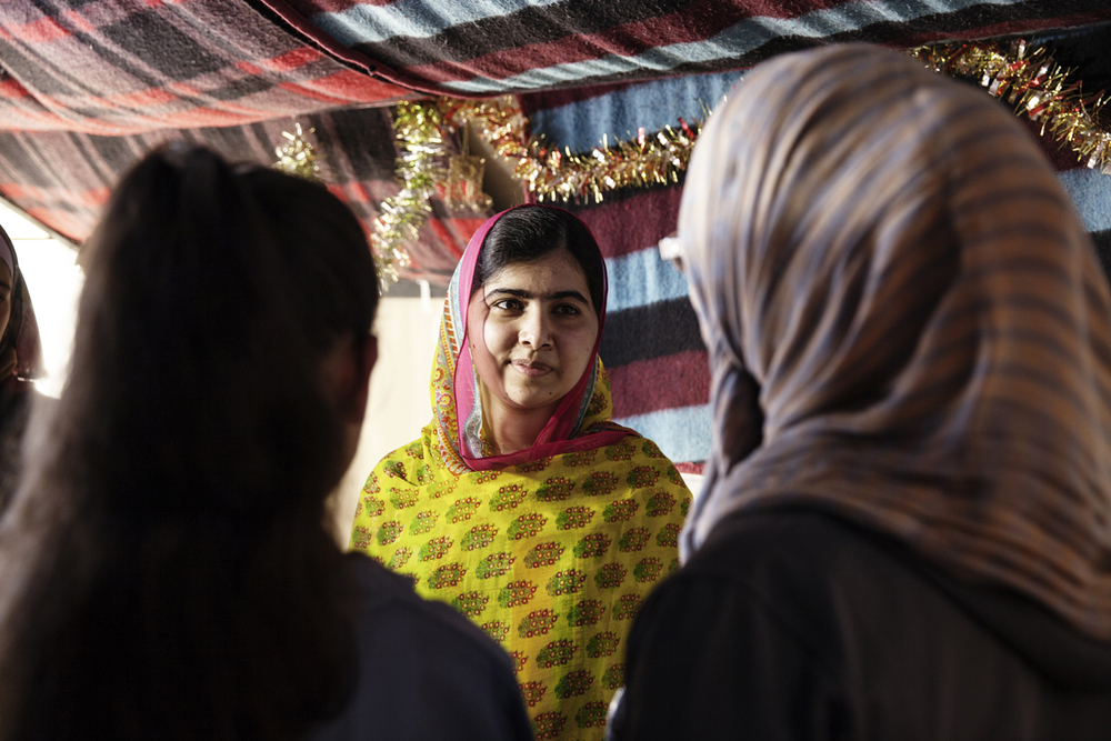 Malala meeting with Syrian refugees in a camp in Bekaa Valley in Lebanon. For the Malala Foundation.