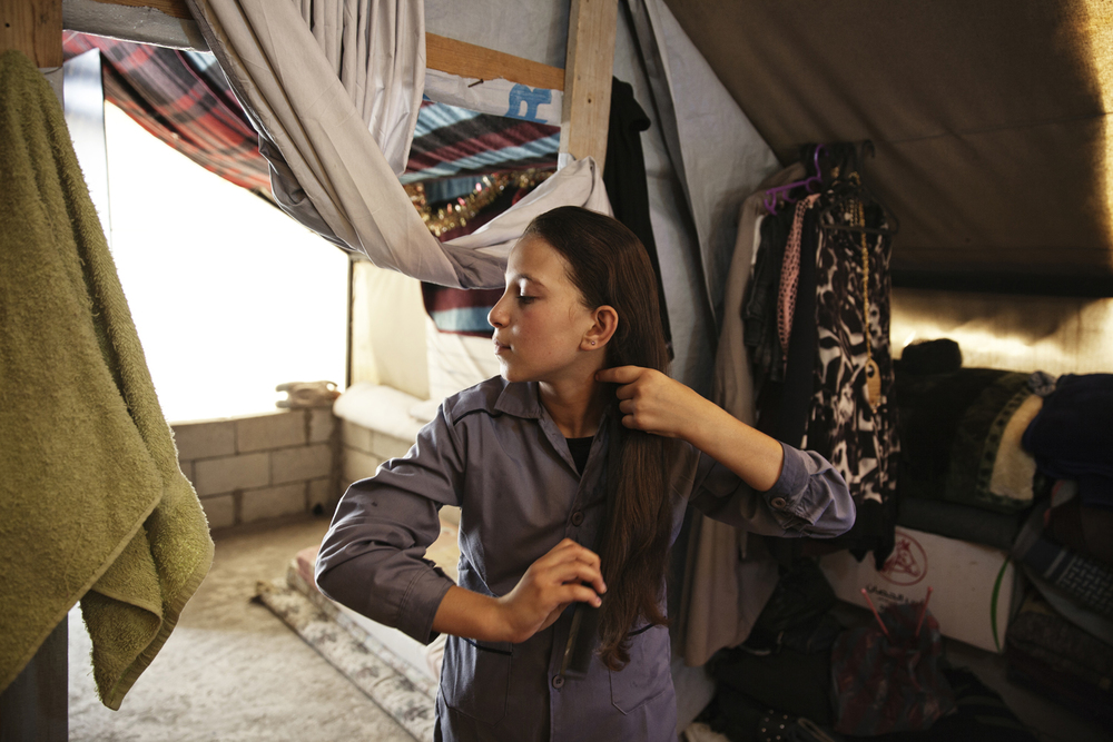 Tasneen in her shool uniform in her home in a Syrian refugee camp in Bekaa Valley in Lebanon. For the Malala Foundation.