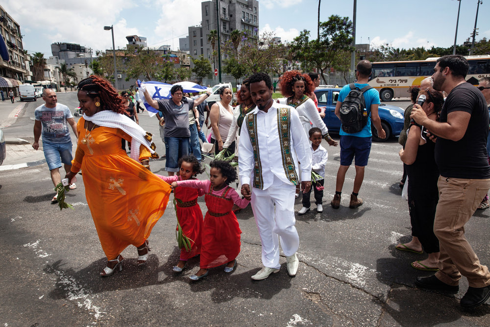 "An Eritrean wedding party happens to cross a fringe right-wing anti-refugee nationalist protest that convenes every Saturday in South Tel Aviv to disrupt church services and other gatherings of Africans. Protestors yelled ""Go back to Eritrea! Stop having babies!"" at the wedding guests."