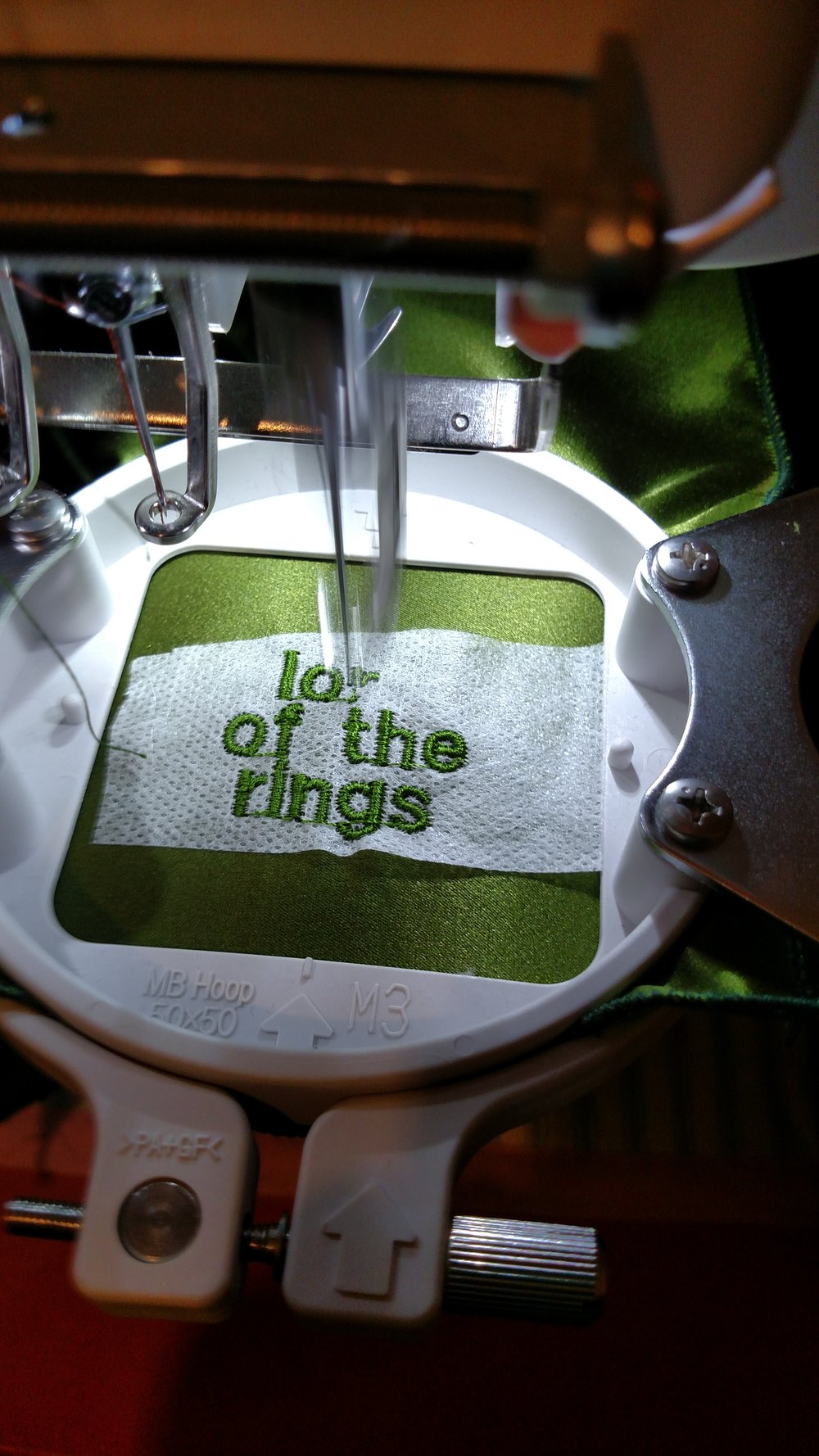 "I also embroidered silk pocket squares for all the men in the bridal party and our ""lord of the rings""/""ring bearer"""