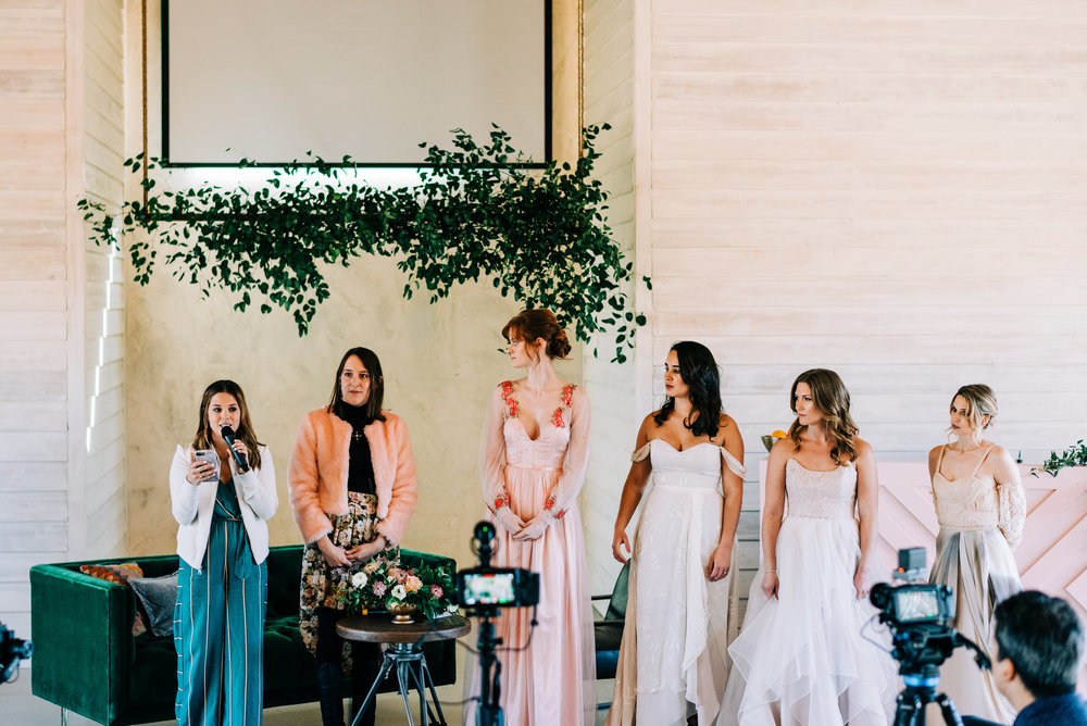 From Left to Right- Abbie Cole Hillis Event Planner, I'm in the pink faux fur coat, Callie my model wearing the Savannah gown, Unknown and Jazmin modelling Moonlight and Moss, and Danielle modelling my gown on the end.