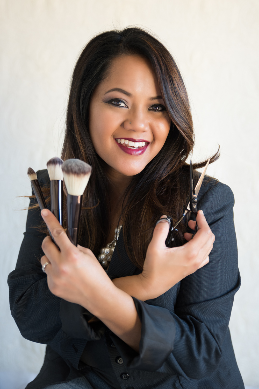 personal branding portrait of hair and make up artist holding her tools