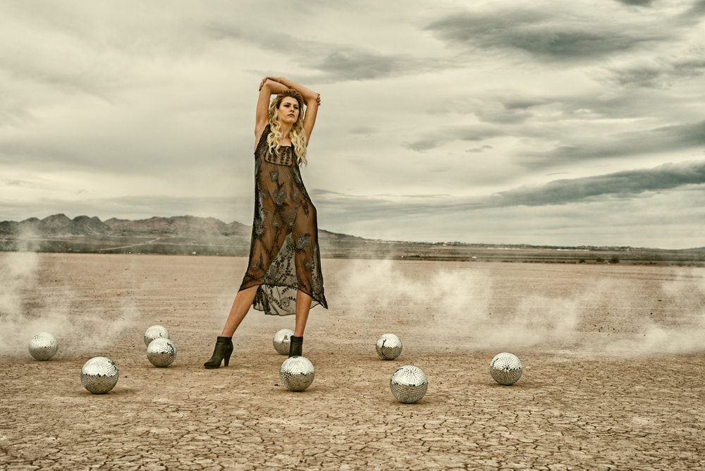 disco balls and smoke in desert photo