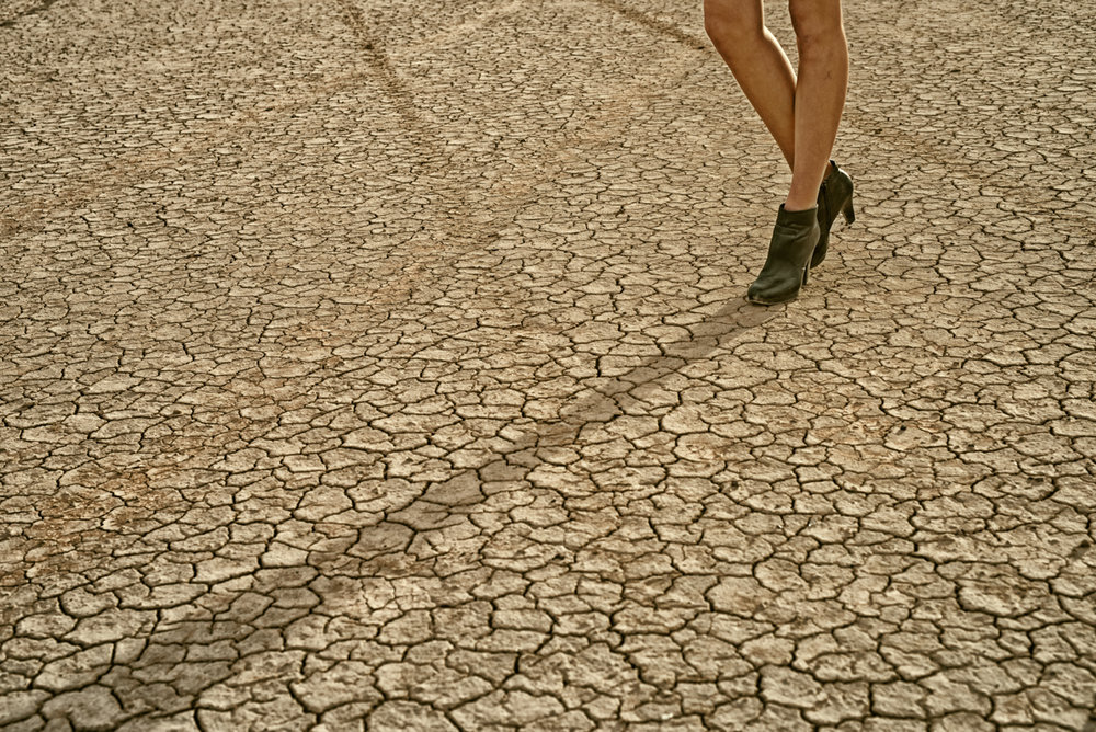 dry lake bed and high fashion shoe