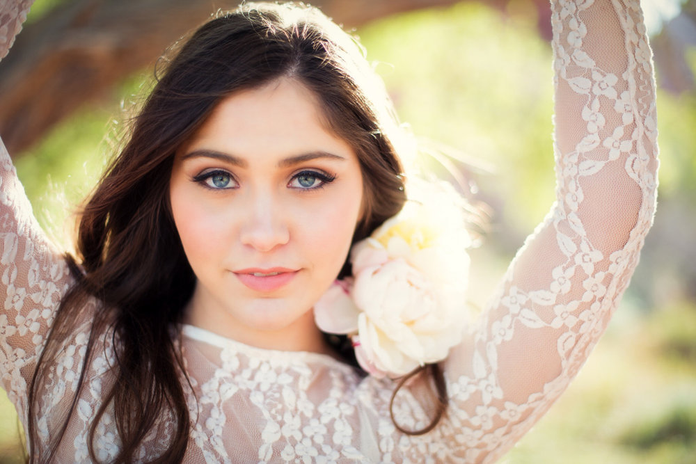 intimate beauty photo with lace top and flowers