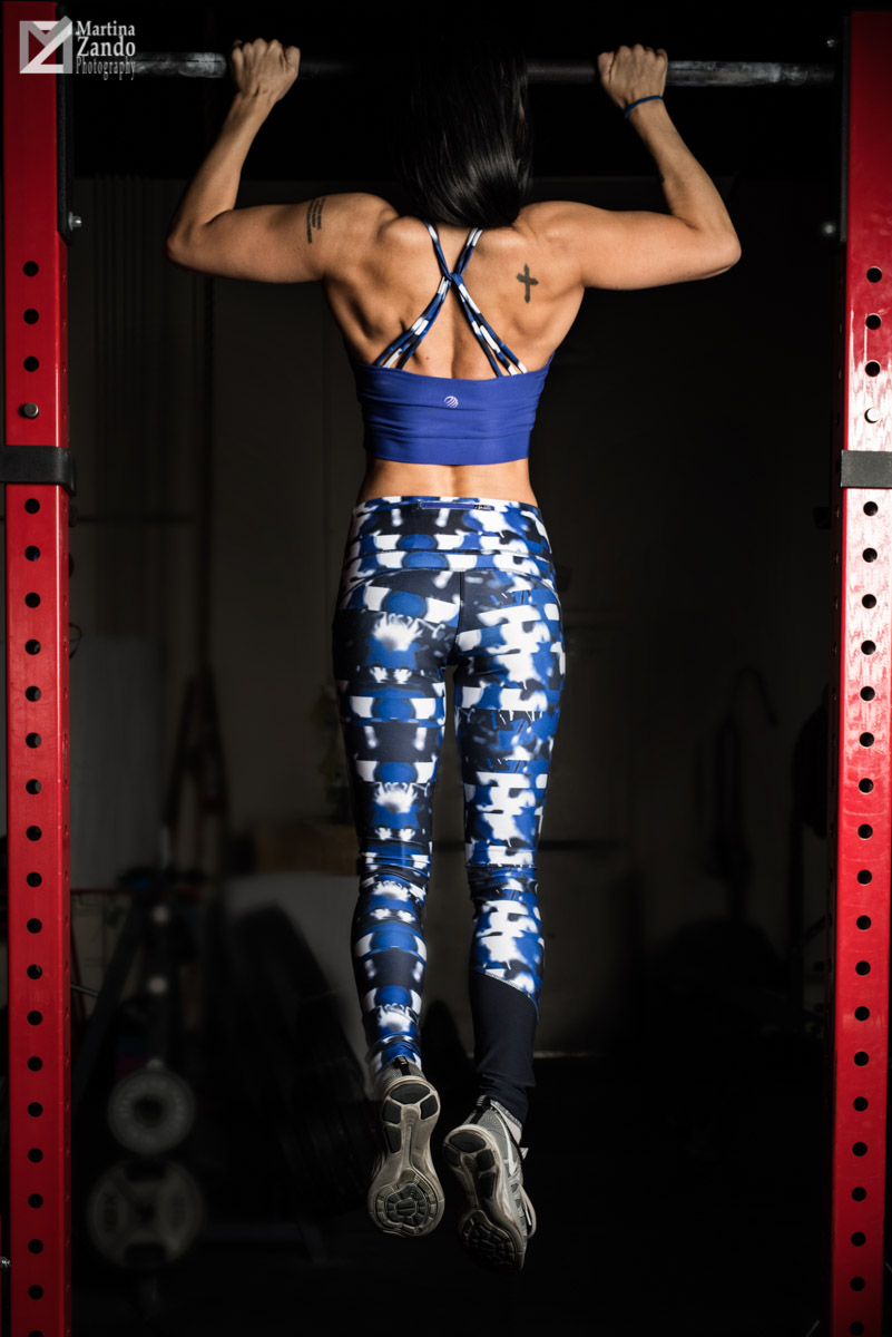 female model doing a chin up
