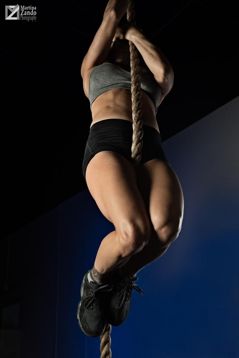 strong women climbing up a rope
