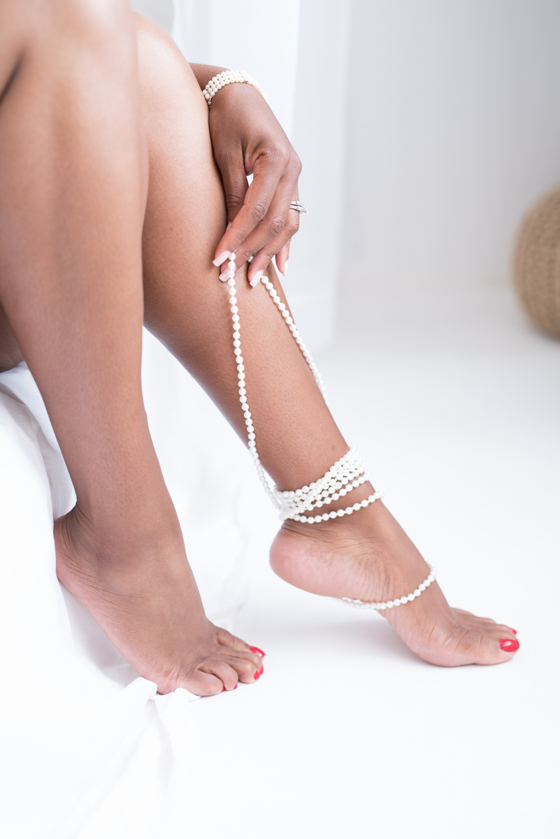 hands and feel with pearls in boudoir