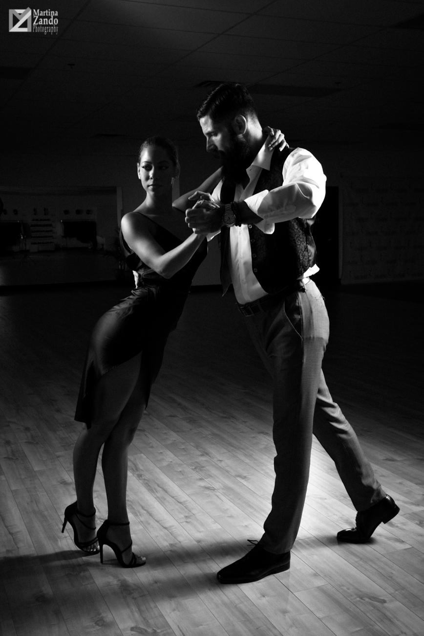 black and white photo passionate tango dancers