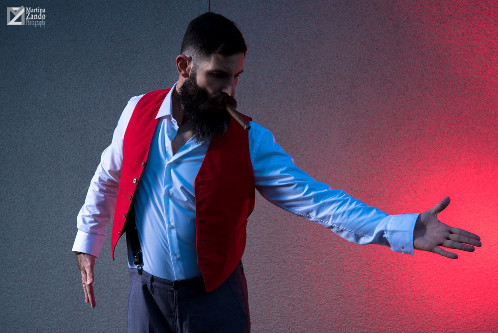 Tango and cigar with red backdrop and waistcoat