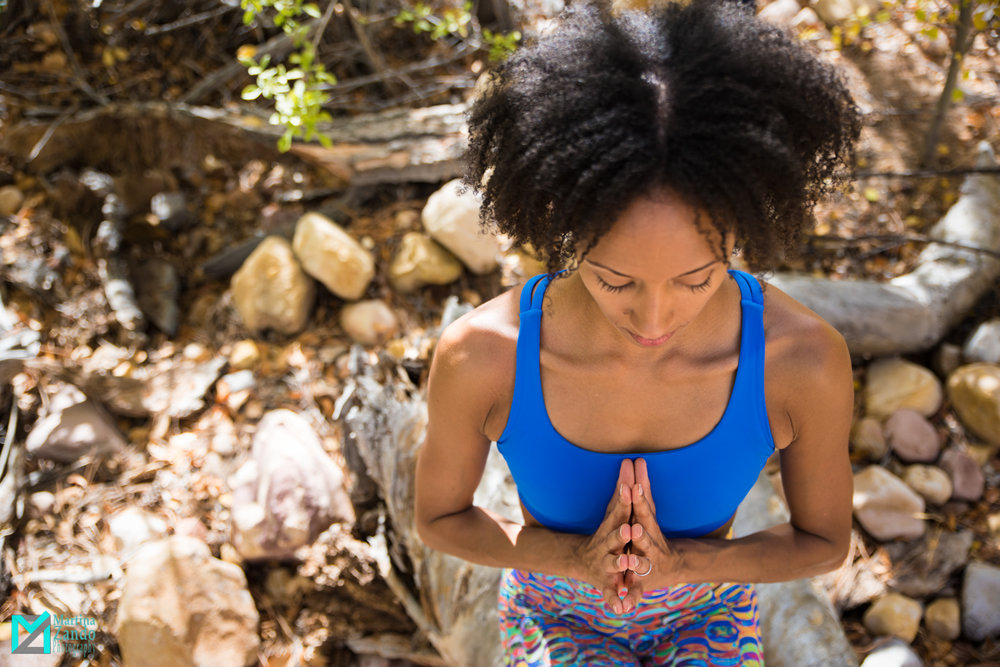 Yoga instructor hands in prayer pose outdoor shoot