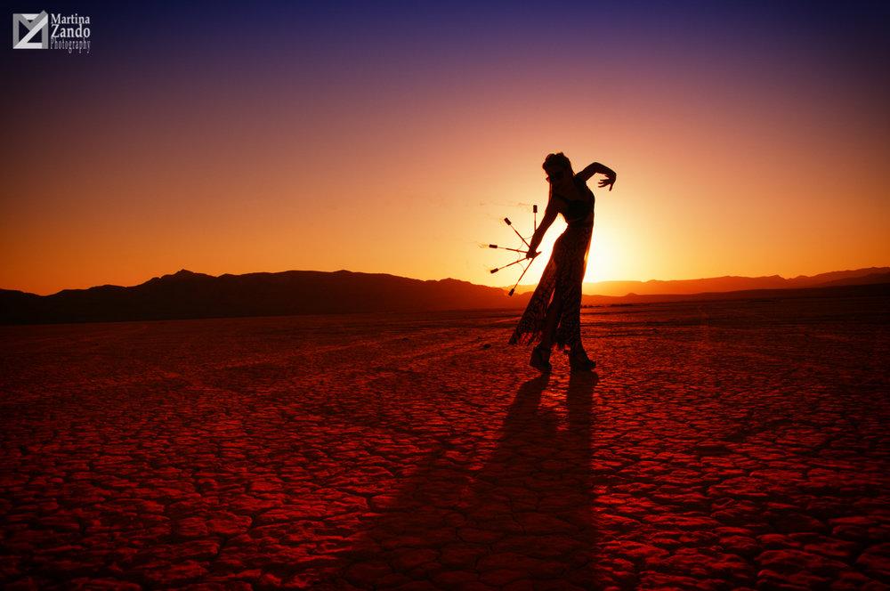 fire performer silhouette in the desert