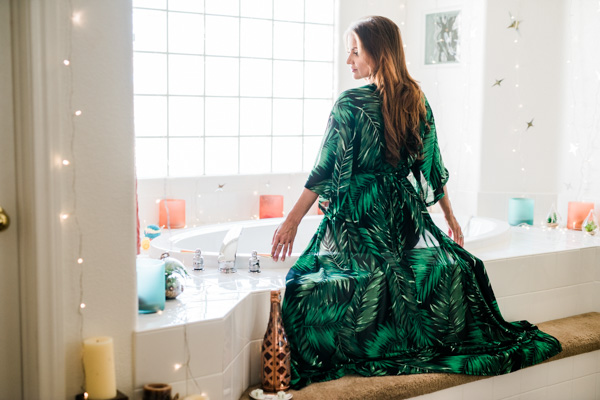 Boudoir Session in the bathtub, bright green robe with plants pattern.   Photo by Martina Zando Photography