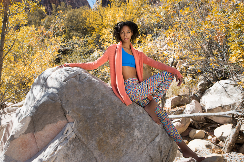 outdoor yoga instructor with bright outfit yellow leaves