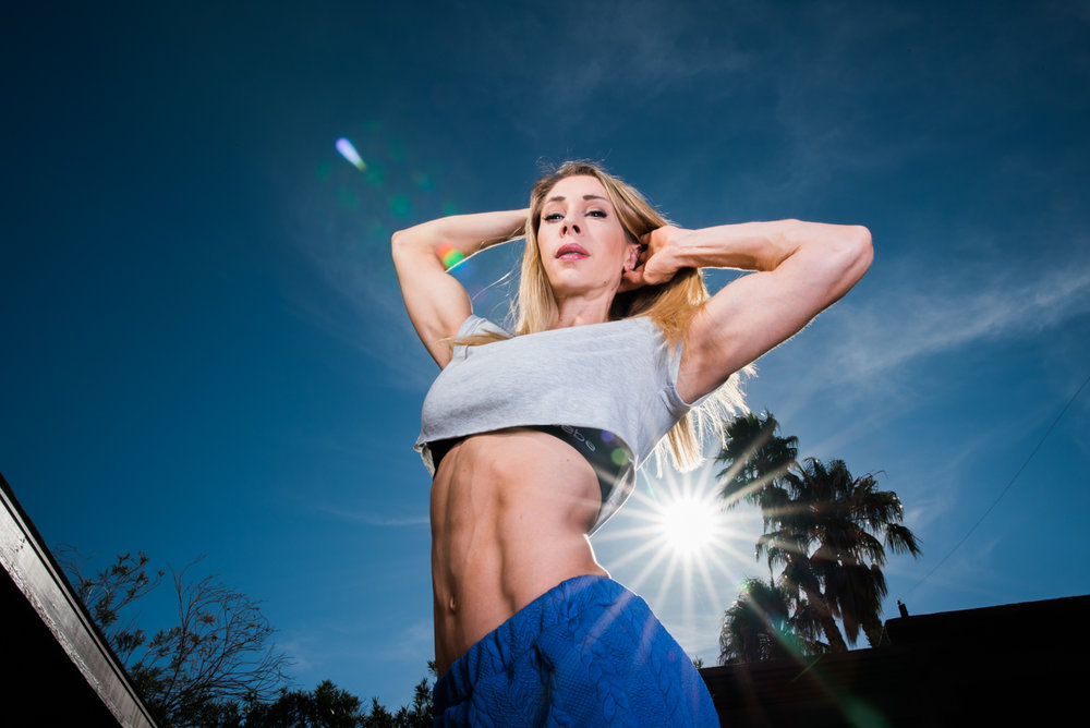 fitness model photoshoot with sun starburs